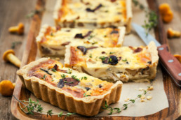 Quiche on wooden tray