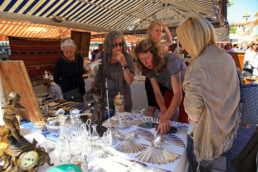 Female Friends looking at French Antiques market goods